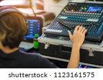 hand adjusting audio mixer.... | Shutterstock . vector #1123161575