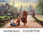 monk receiving food and items... | Shutterstock . vector #1123187258