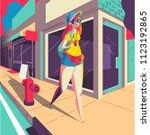 girl walking on the street... | Shutterstock .eps vector #1123192865