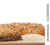 Small photo of Loaf of bread, lint and sesame on cutting board on wooden background