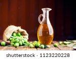 bottle of oilve oil on wooden...   Shutterstock . vector #1123220228