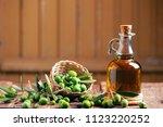 bottle of oilve oil on wooden...   Shutterstock . vector #1123220252