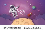 astronaut astronaut floating in ... | Shutterstock .eps vector #1123251668