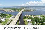 A bridge and highway crossing a huge body of water in Mississippi on a summer day.