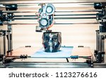 3d printer printing a model in...   Shutterstock . vector #1123276616