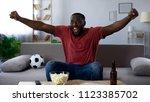 afro american man watching... | Shutterstock . vector #1123385702