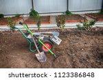 two wheeled wheelbarrow loaded... | Shutterstock . vector #1123386848