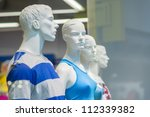 Mannequins in sport athletics suits in mall - stock photo