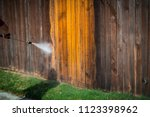 power washing wooden fence to... | Shutterstock . vector #1123398962