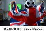 man holding great britain flag  ... | Shutterstock . vector #1123402022