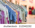 Clothes for young babies in kids mall - stock photo