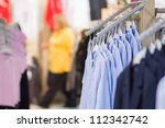 Stands with blouses in kids mall - stock photo