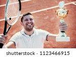 tennis champion. winner of the...   Shutterstock . vector #1123466915