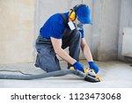 concrete floor surface grinding ... | Shutterstock . vector #1123473068