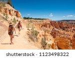 girls on summer vacation hiking ... | Shutterstock . vector #1123498322