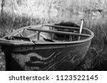 Abandoned Canoe On The Shore O...