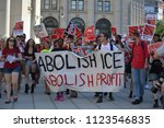 Small photo of New York City, June 29, 2018 - People marching to convince the government to abolish ICE in Lower Manhattan.