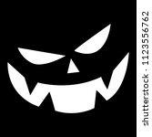 halloween pumpkin face on a... | Shutterstock .eps vector #1123556762