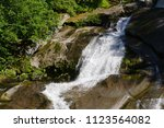 Water Falling Over Rocks At...