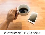 coffee cup and smartphone | Shutterstock . vector #1123572002