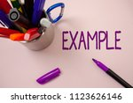 Small photo of Handwriting text writing Example. Concept meaning Illustration Sample Model to follow Guide Explanation For instance White background purple pen markers ideas messages inspirational inspire.