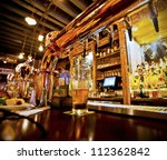 Stock photo pint of beer on a bar in a traditional style pub 112362842