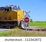A Speeding Train Crossing A...