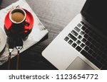 blurred cup coffee with laptop... | Shutterstock . vector #1123654772