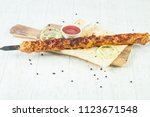 grilled minced chicken kebab... | Shutterstock . vector #1123671548