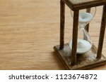hourglass on the oak table as... | Shutterstock . vector #1123674872