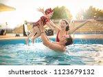 beautiful family having fun in... | Shutterstock . vector #1123679132