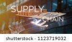 view of a businessman holding a ... | Shutterstock . vector #1123719032