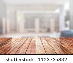 closeup top wood table with... | Shutterstock . vector #1123735832