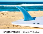 The Surfboard With Blue Long...