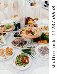 a lot of food in a restaurant... | Shutterstock . vector #1123756658