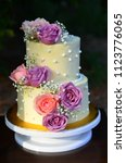 wedding cake with fresh flowers | Shutterstock . vector #1123776065