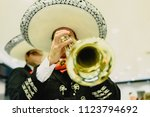 mexican musician with his... | Shutterstock . vector #1123794692