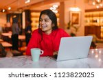 portrait of a young indian... | Shutterstock . vector #1123822025