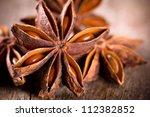 anise stars on wooden background | Shutterstock . vector #112382852