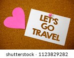 Small photo of Handwriting text Let'S Go Travel. Concept meaning Going away Travelling Asking someone to go outside Trip Hart love pink brown background love lovely thoughts message memories.