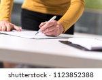 Businesswoman Signing Document...