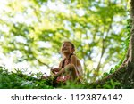 girl playing in the park | Shutterstock . vector #1123876142