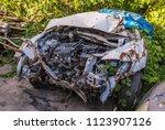 car wreck and evening light | Shutterstock . vector #1123907126