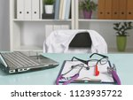 doctor's workspace working... | Shutterstock . vector #1123935722
