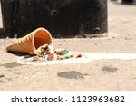 melted ice cream and cone on... | Shutterstock . vector #1123963682