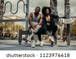 young happy black couple... | Shutterstock . vector #1123976618