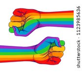 rainbow colored hand with a... | Shutterstock .eps vector #1123985636