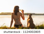 beautiful slim woman with pet... | Shutterstock . vector #1124002805