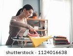 pretty housewife in good mood... | Shutterstock . vector #1124016638