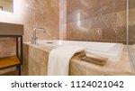 modern marble tiled bathroom | Shutterstock . vector #1124021042
